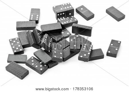 Heap of domino game stones lying on white background