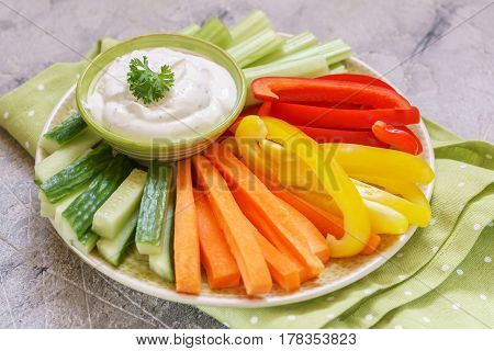Platter of assorted fresh vegetables with ranch dip