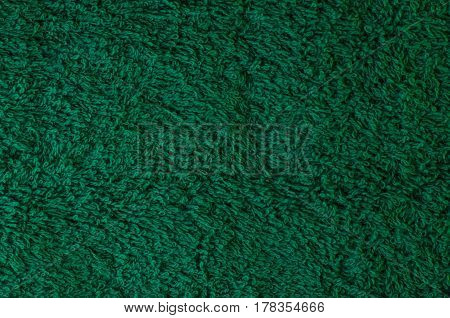 Green soft terry towel in the form of a close-up texture