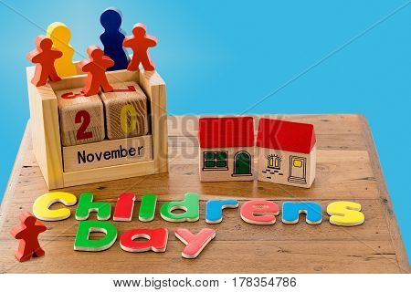 Childs wooden blocks and magnetic letters spell out Children's Day for 20 November