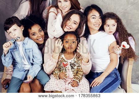 Lifestyle and people concept: young pretty diversity nations woman with different age children celebrating on birthday party together happy smiling, making selfie. African-american, asian and caucasian close up