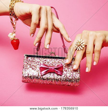 little girl stuff for princess, woman hands holding small cute handbag with jewelry and manicure, luxury lifestyle concept close up