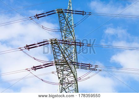 electricity transmission tower on a power house