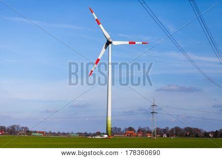 a german wind turbine in a landscape