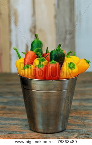 Fresh Colorful Peppers In Silver Bucket On Wooden Table