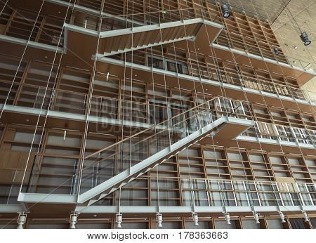 staircase along the wall with racks in showroom
