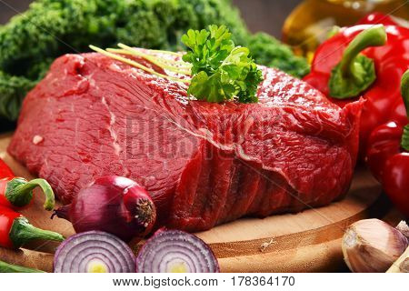 Piece Of Beef And Spices On Cutting Board