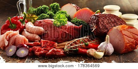 Variety Of Meat Products Including Ham And Sausages