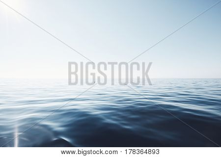 Tranquil summer sunny seascape of calm sea with gentle ripples meeting blue clear cloudless sky with lonely dolphin on horizon - peace, harmony and serenity concept
