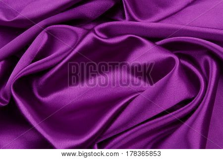 Closeup of rippled purple silk fabric