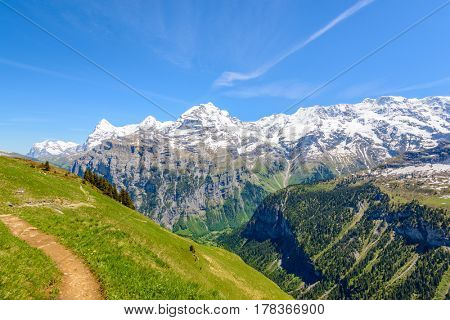 Crossing the Alps. Hiking trail in the Alps. Murren. Switzerland.