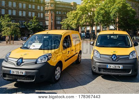 STRASBOURG FRANCE - JUN 24 2016: Postal delivery electric Renault mini van in central Square Place Kleber early in the morning. La Poste is France's leading employer with a total workforce of 300000 working in postal shipping and banking branches