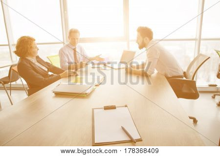 Toned of business people communicating with new worker and suggesting him appropriate contract to work in huge company, firm, enterprise. Employee concept.