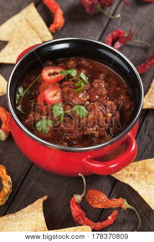 Mexican chili con carne with hot peppers and tortilla chips
