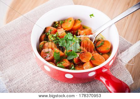 Baby carrots cooked with garlic, honey and parsley.