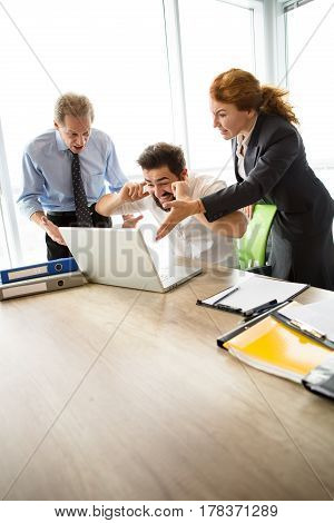 Mobbing, stress, work, scandal concepts. Angry bosses man and woman screaming at their executive worker, because they are not satisfied with his work.