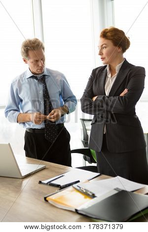 Mobbing, stress, work, scandal concepts. Two angry bosses man and woman communicating in office and waiting for their worker to scream at.