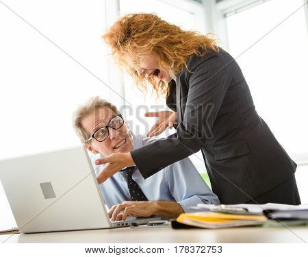 Mobbing, stress, work, scandal concepts. Business people have conflict working problem. Angry boss expressing negative emotions to her worker in office.