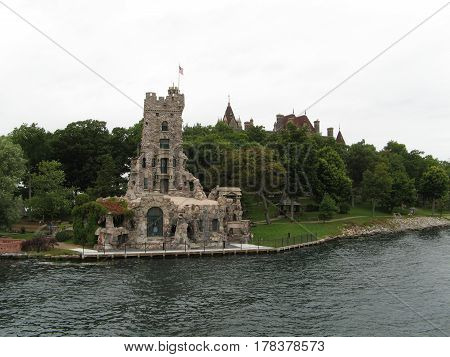 stone castle island green trees shore  tour