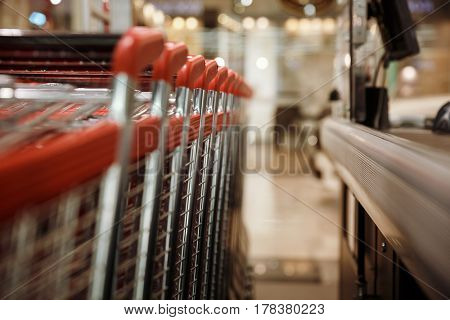 Image a lot of shopping trolleys in supermarket