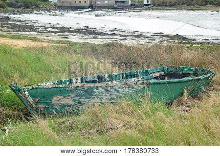 Green abandoned boat in the Atlantic Ocean