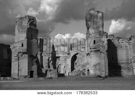 Ancient Baths of Caracalla ruins in the historic center of Rome with beautiful clouds (Black and White)