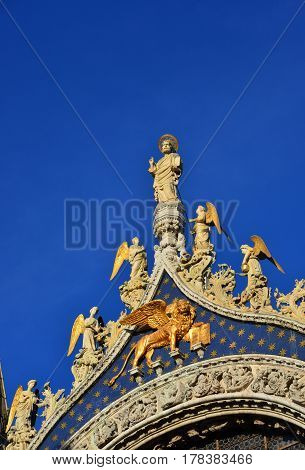 Saint Mark Basilica top statues shines like gold at sunset in Venice (with copy space)