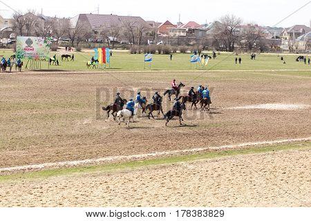 Shymkent, KAZAKHSTAN - 22 March 2017: Celebration of the Kazakh holiday NARIYZ. Competitions on horses .