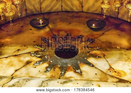 BETHLEHEM, PALESTINE - NOVEMBER 18, 2016 Christ Birth Spot Grotto Over Cave Where Jesus Christ Born Church of the Nativity Bethlehem West Bank Palestine. Star allows believers to touch spot on actual floor of cave where Jesus born. Location of Jesus birth