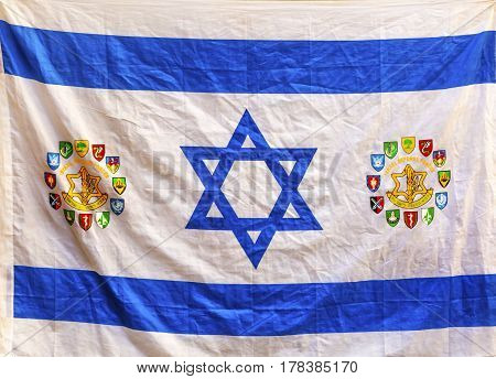 JERUSALEM, ISRAEL - NOVEMBER 18, 2016 Israeli Flag Western Star of David Jerusalem Israel. Israeli/Israel Flag with Symbols Different Divisions of IDF Israeli Defense Force Israeli army.