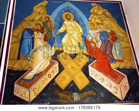 MADABA, JORDAN - NOVEMBER 25, 2016  Risen Chirst Raisiing Christians Fresco Saint George's Greek Orthodox Church Madaba Jordan. Church was created in the late 1800s and houses many famous mosaics