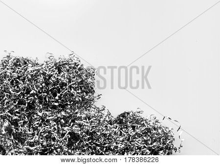 Abstract modern background of a heap of metal shavings and scraps. Twisted steel wire close-up. Texture of silver curly swarfs