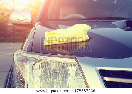 Microfiber cloth on surface of car shine.