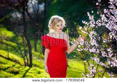 Spring girl. Beautiful model with flower wreath on her head. Close up portrait of romantic sensual lady with blue eyes and long shiny hair. Dreaming princess in lacy dress looking afar.