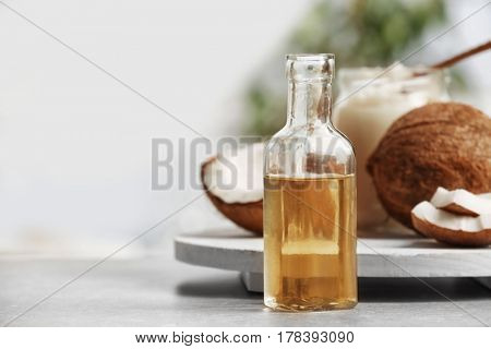 Fresh coconut oil in glassware on grey table