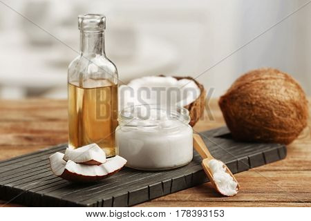 Fresh coconut oil in glassware on wooden table