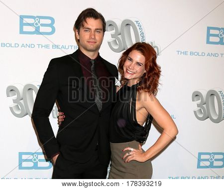 LOS ANGELES - MAR 23:  Pierson Fode, Courtney Hope at the celebration of 30 Years of Bold and Beautiful and their 23 Emmy nominations at CBS on March 23, 2017 in Los Angeles, CA