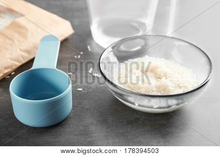 Glass bowl with rice on kitchen table