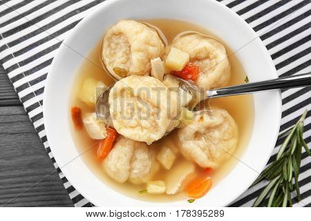 Portion of delicious chicken and dumplings on dining table