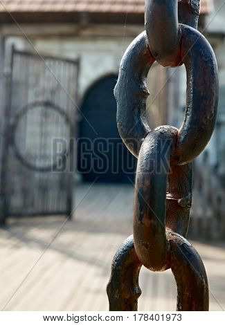 Close up photo of old gate chain in Dubno, Ukraine