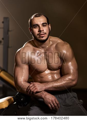 Portrait of physically fit young man resting after training