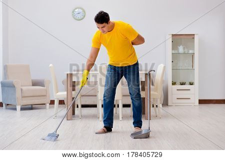 Man cleaning the house helping his wife