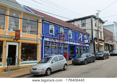 LUNENBURG, NS, CANADA - MAY 22, 2016: Lunenburg Post Office in town center of Lunenburg, Nova Scotia, Canada. The historic town was designated a UNESCO World Heritage Site since 1995.
