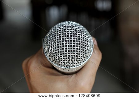 Microphone On A Man Hand