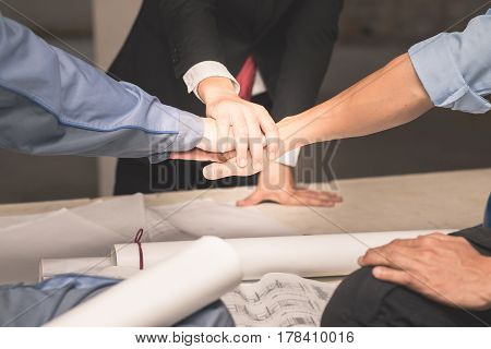 Hands of collaboration teamwork concept with engineer architect and interior over blueprint background with vintage tone Success business team conceptual