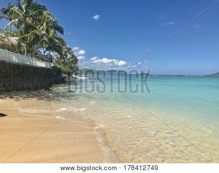 The beautiful clear waters of Lanikai Beach on the windward side of Honolulu, Hawaii. Photo taken March, 2017.