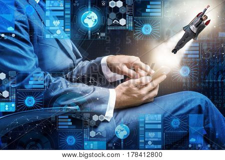 Businessman with smartphone in startup concept