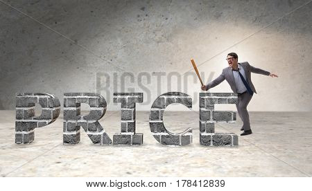 Angry man with baseball bat hitting price word