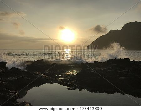 A gorgeous sunrise from the tide pools of Makapu'u Beach in Oahu, Hawaii.