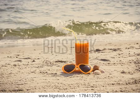 Vintage Photo, Carrot Juice And Sunglasses At Beach, Concept Of Vitamin A And Beautiful, Lasting Tan